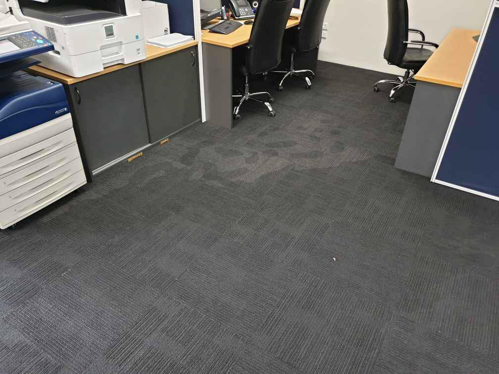 wet carpet tiles in office