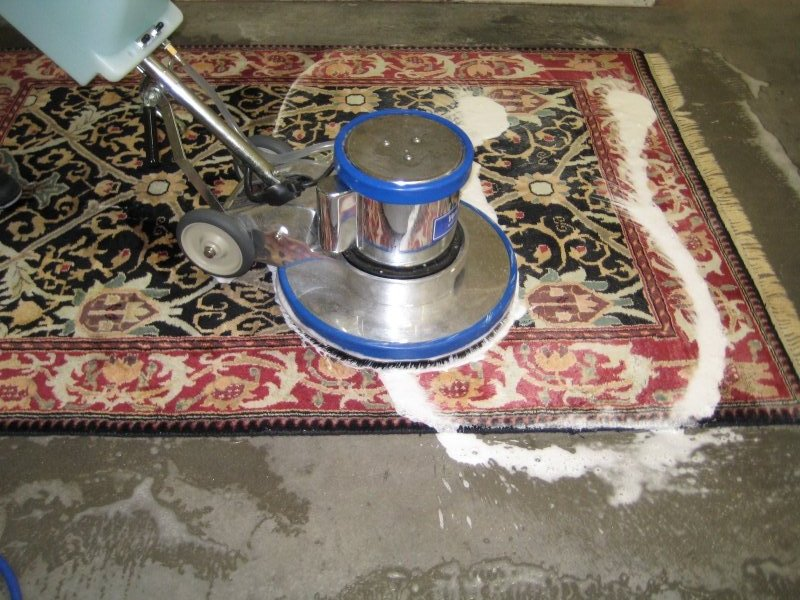 cleaning rug with a heavy equipment