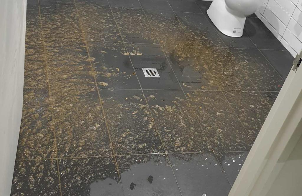 sewage spill in a unisex toilet in Melbourne West