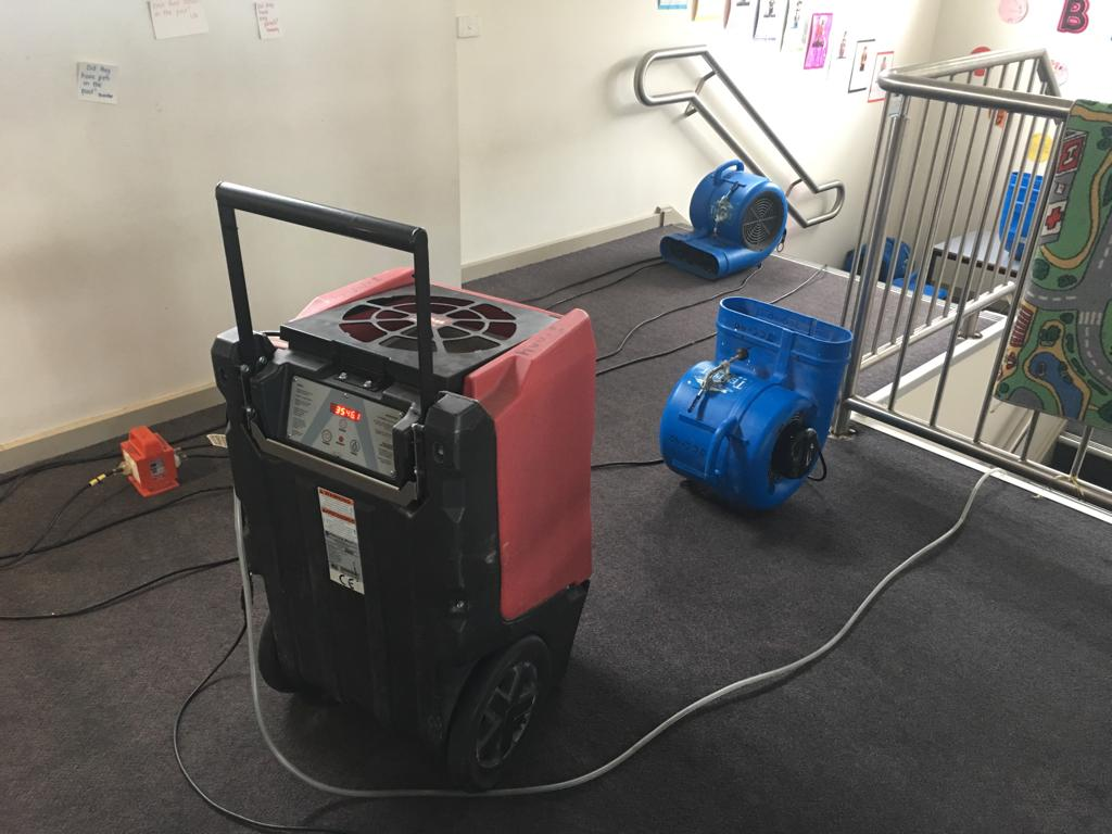 water damage carpet cleaning and ceiling drying in school